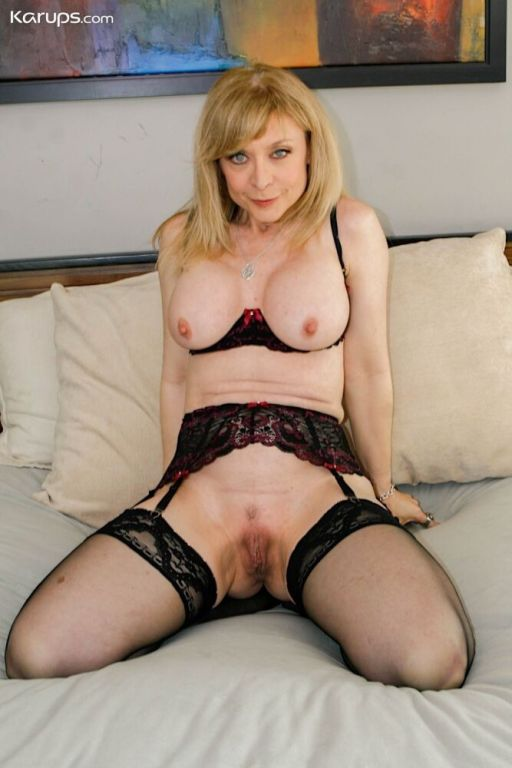 Nina Hartley busty blonde strips and shows legs in