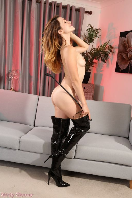 Tess Lyndon in black PVC corset and thighhigh boot