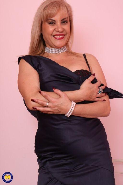Ruby Stone mature blonde in black stockings stripp