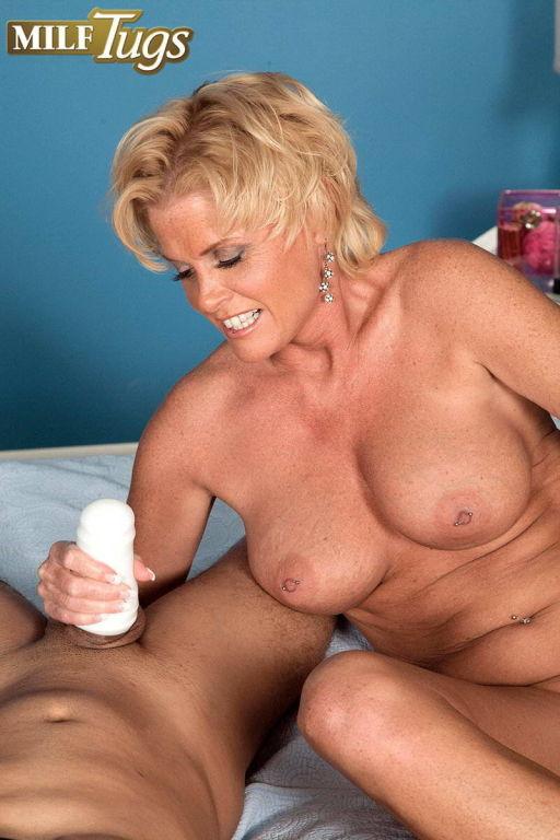 Mature Trixie Blu gives hand job and blow job