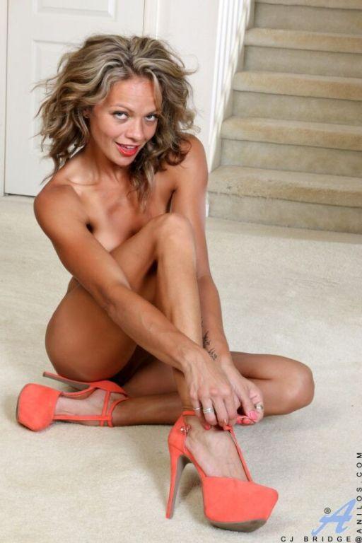 Sexy busty milf blonde Sj Bridge spreads nude on a