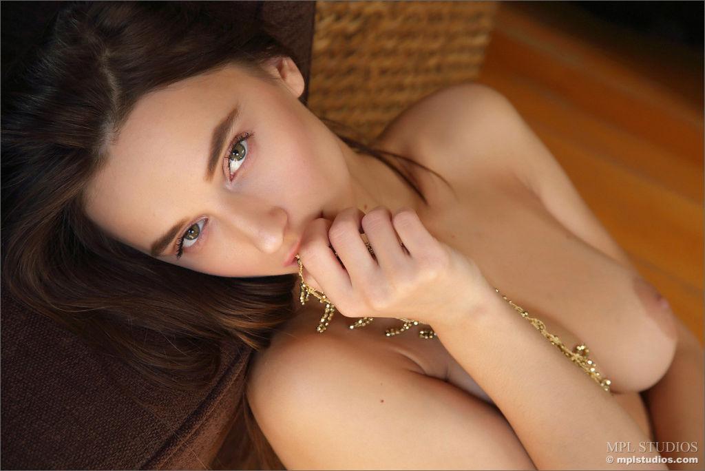 Pretty Gloria Sol teasing in her golden mesh top